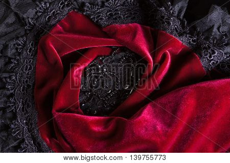 Background image made of beaded velvet with black lace