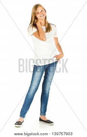 Young girl standing smiling with white t-shirt and blue jeans over white background