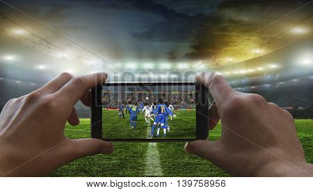 Football fan removes the football game on mobile phone