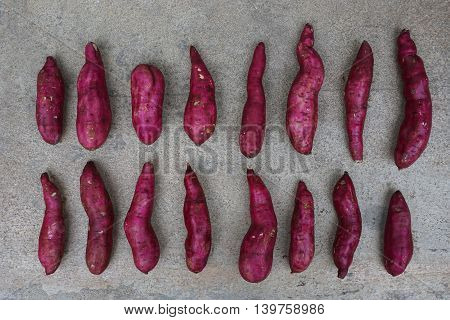 close up raw red sweet japanese potatoes