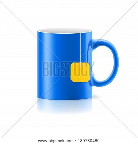 Blue cup with tea bag label from standing on white background