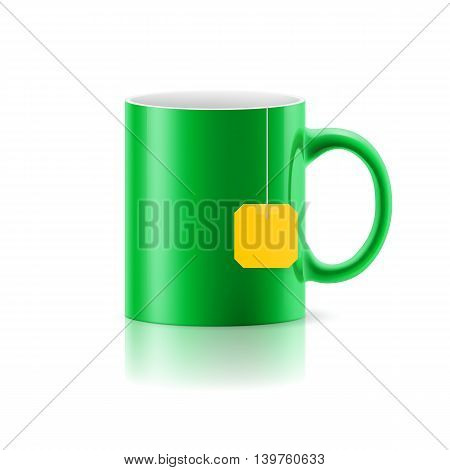 Green cup with tea bag label from standing on white background