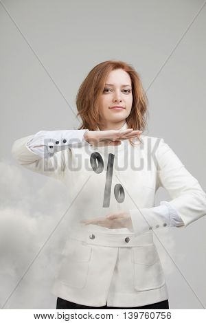 Woman showing symbol of percent. Bank Deposit or Sale concept.