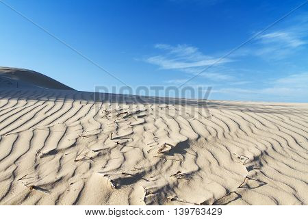 Beautiful photo of sand in the desert against the sky.