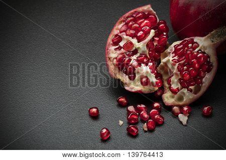 pomegranate on black