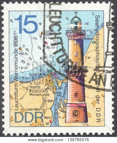 MOSCOW RUSSIA - JANUARY 2016: a post stamp printed in DDR shows the Leuchttum Warnemunde lighthouse the series