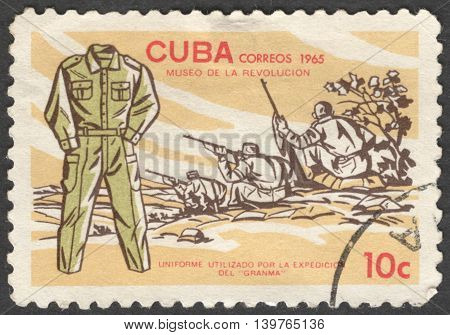 MOSCOW RUSSIA - JANUARY 2015: a post stamp printed in CUBA shows a soldier's uniform of Granma the series