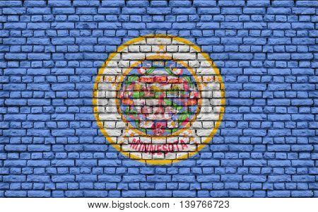 Minnesota US flag painted on old vintage brick wall