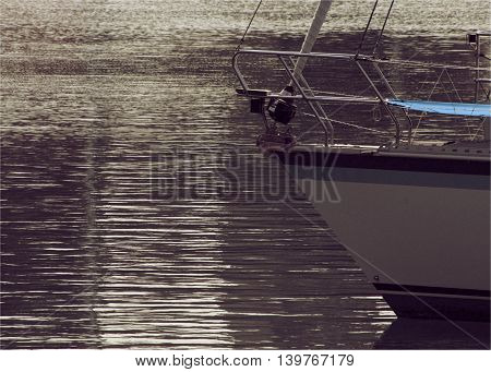 Sailing Boat floating in crispy bay water