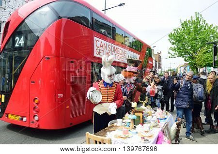 CAMDEN HIGH STREET LONDON ENGLAND 5 May 2015: Mad Hatters Tea Party on street