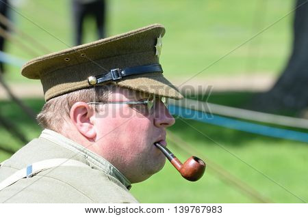 CRESSING TEMPLE ENGLAND 17 May 2015: Man in reenactment uniform enjoying a pipe