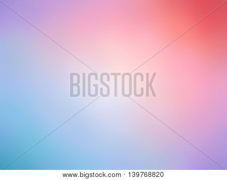 Abstract red pink blue purple colored blurred background.