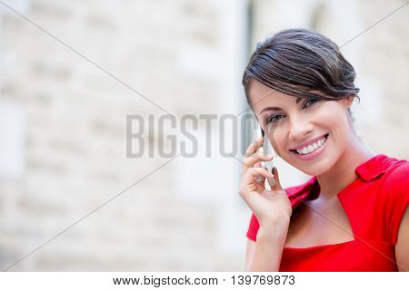 Portrait of businesswoman with mobile phone