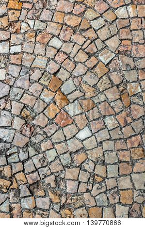 Background with a pattern and texture of ancient cobble stones