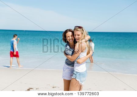 Woman friends on the beach