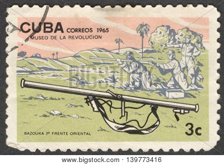 MOSCOW RUSSIA - JANUARY 2015: a post stamp printed in CUBA shows a bazooka gun and soldiers the series