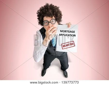 Disappointed Businessman Is Showing Document With Denied Mortgag