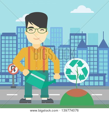 An asian young man watering a tree with a recycle sign instead of crown on a city backround. Eco-friendly man takes care of the environment. Vector flat design illustration. Square layout.