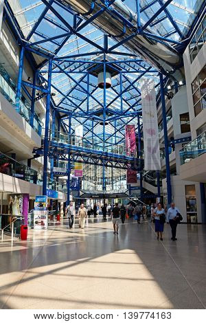 BIRMINGHAM, UNITED KINGDOM - JUNE 6, 2016 - Shoppers walking through the International Convention Centre mall Birmingham England UK Western Europe, June 6, 2016.