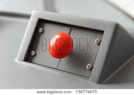 Big red button round shape, close-up.