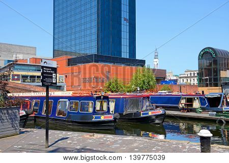 BIRMINGHAM, UNITED KINGDOM - JUNE 6, 2016 - Rear view of the Hyatt Hotel with narrowboats in the foreground at Gas Street Basin Birmingham England UK Western Europe, June 6, 2016.