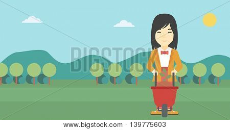 An asian young woman standing with a plant and soil in a wheelbarrow on the background of mountain landscape. Vector flat design illustration. Horizontal layout.