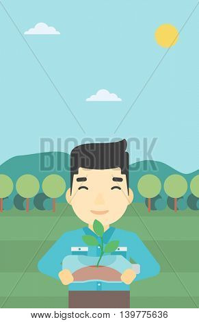 An asian young man holding in hands plastic bottle with plant growing inside. Man holding plastic bottle used as plant pot. Recycling concept. Vector flat design illustration. Vertical layout.