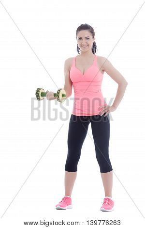 Studio shoot of a woman doing an exercise with a dumbbell created with cucumber and pineapple