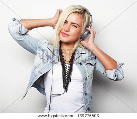 Pretty young girl enjoys listening music