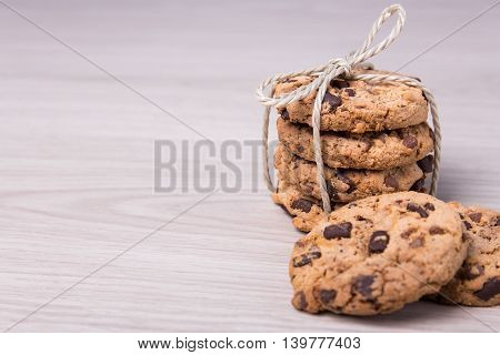 Close Up Of Freshly Baked Chocolate Chip Cookies And Copy Space On Wooden Background