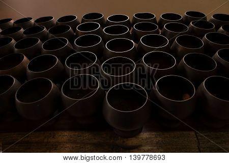 monk's alms bowl in temple. dark tone