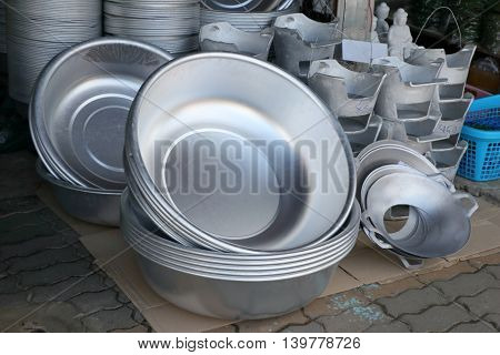 large group of vintage aluminum kitchen utensils in local market at Thailand