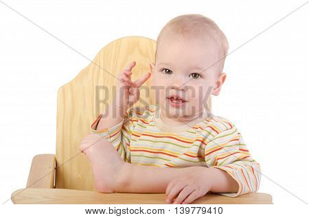 Cute boy sitting on a chair over white