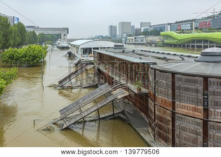 Paris, France - June 5 2016: Ships restaurant on the River Seine are seriously damaged due to massive flooding in Paris during the first days of June 2016.