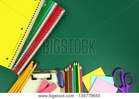 Back to School Supplies on Blank Chalkboard