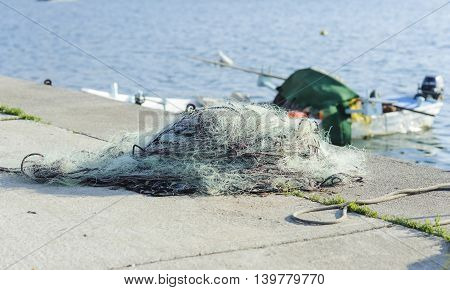 Fishing net to dry on the pier.