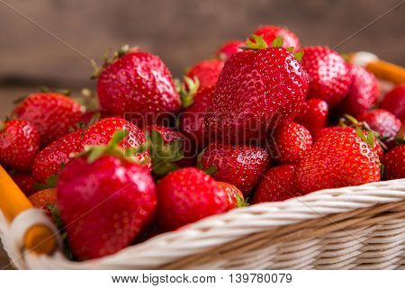 Pile of ripe strawberries. Berries in a basket. Ingredient of fruit pie. Fresh from the garden.