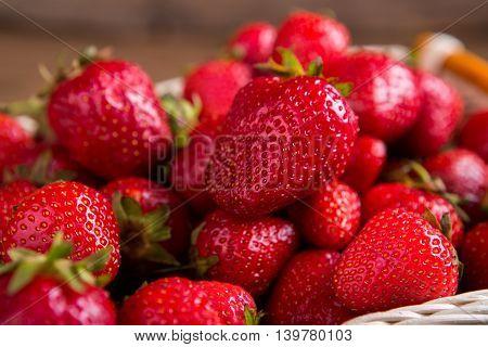 Pile of strawberries. Ripe red berries. Ingredient for vegetarian pastry. Sweet and juicy.