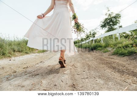 Pregnant Woman Walking With Flowers
