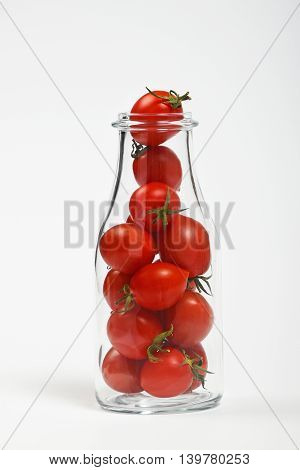 Cherry Tomatoes In Glass Bottle Over White