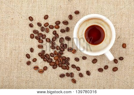 Empty Espresso Cup And Coffee Beans On Canvas