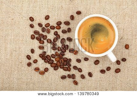 Full Espresso Cup And Coffee Beans On Canvas