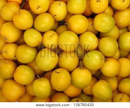 Background Of Fresh Yellow Plums Close Up