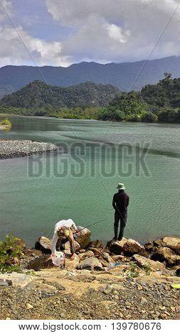 They are fishing together on the river
