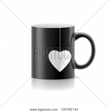 Black cup with teabag in the form of heart