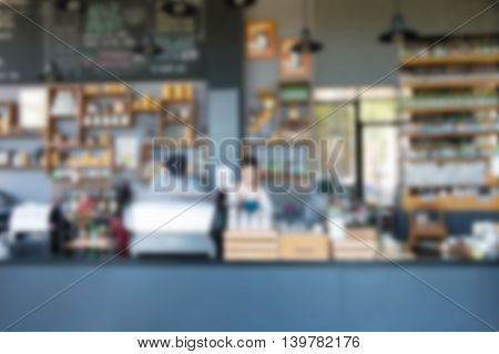view people behide counter inside busy coffee shop