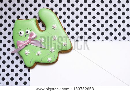 A cute polka dot background with a handmade honey-cake cat and a place for your text for a baby shower party, a birthday party  or other events.