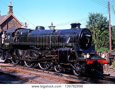 HIGHLEY, UK - JULY 18, 1993 - British Railways Standard Class 4 4-6-0 steam locomotive number 75069 pulling out of Severn Valley railway Station Highley Shropshire England UK Western Europe, July 18, 1993.