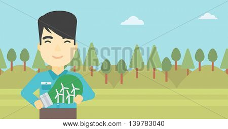 An asian man standing on the background of green forest and holding in hands a big light bulb with small wind turbines inside. Green energy concept. Vector flat design illustration. Horizontal layout.