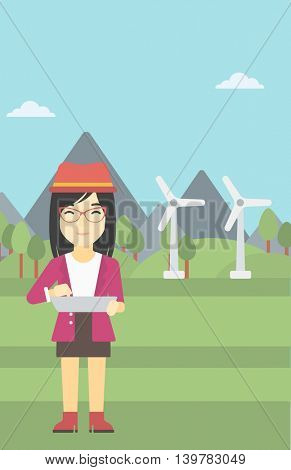 An asian woman holding a laptop hands on a background with solar pannels and wind turbins. Woman working on computer. Vector flat design illustration. Vertical layout.